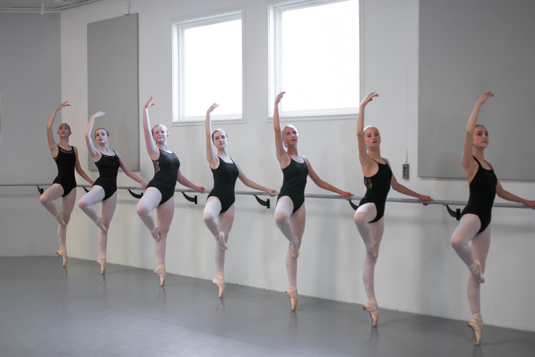 Advanced Ballet Dancers in a Company Performance